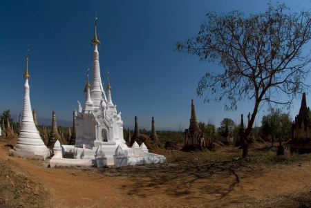 inle: White small pagodas of Inn Taing temple on Inle lake in Myanmar
