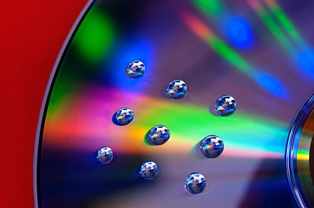 Multicolor and water drops on DVD-disc  photo
