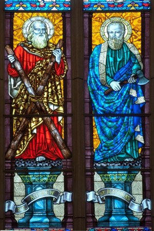 A colorful of St Andrew and St Matthias stained glass church window