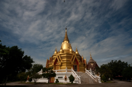 Golden pagoda in temple at Middle of Thailand  photo