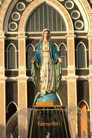 holy mary: Holy Mary statue front of Gothic style Church in East of Thailand