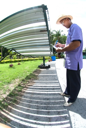 Asian man working on solar cell  photo