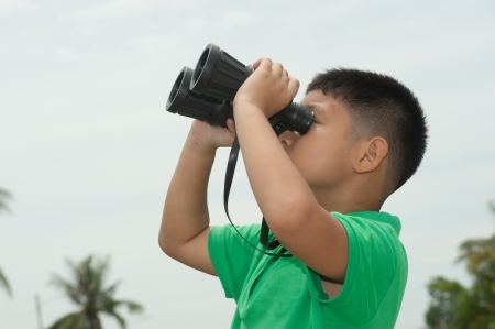 Young boy with binocular  photo
