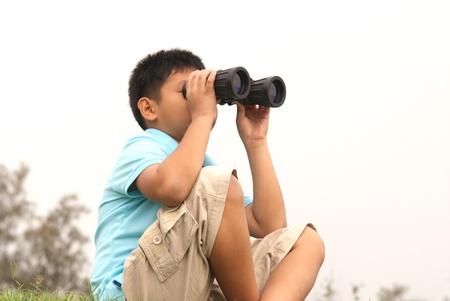 Young boy with binocular  photo