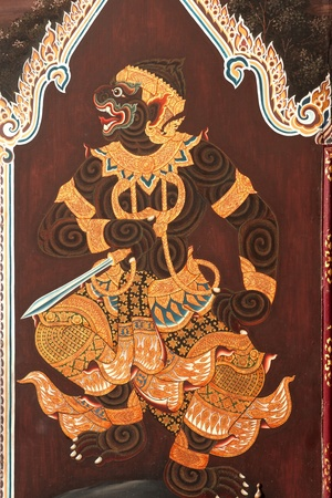 Thai art of Ramayana story on the door in Thai temple