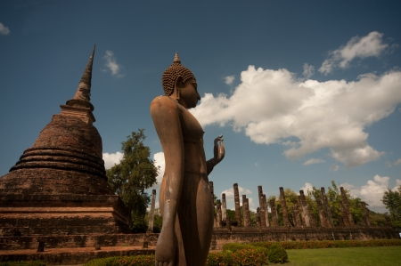 Ancient Pagoda and buddha in the temple ruins of Sukhothai historical park,Northern of Thailand   photo