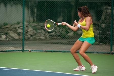 BANGKOK,THAILAND- NOV 29    Jeannine Prentner of Austria player tennis returns ball to Jeannine Prentner of Austria player at semi final match,during Chang ITF Pro Circuit 2012 on November 29,2012 at Rama Garden Hotel in Bangkok,Thailand