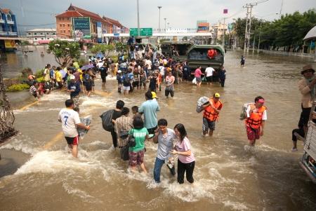 AYUTTHAYA, THAILAND - OCTOBER 9  Heavy flooding from monsoon rain in Ayutthaya and north Thailand arriving in Ayutthaya suburbs on October 9, 2011 in Ayutthaya, Thailand  Stock Photo - 16680365