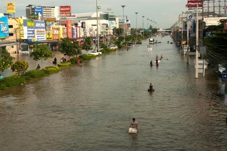 AYUTTHAYA, THAILAND - OCTOBER 9  Heavy flooding from monsoon rain in Ayutthaya and north Thailand arriving in Ayutthaya suburbs on October 9, 2011 in Ayutthaya, Thailand