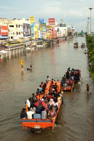 AYUTTHAYA, THAILAND - OCTOBER 9  Heavy flooding from monsoon rain in Ayutthaya and north Thailand arriving in Ayutthaya suburbs on October 9, 2011 in Ayutthaya, Thailand  Stock Photo - 16680393
