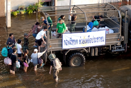 BANGKOK, THAILAND-OCTOBER 30   Transportation of people in the streets flooded after the heaviest monsoon rain in 50 years in the capital on October 30, 2011 Phahon Yothin Road, bangkok,  Stock Photo - 16680397
