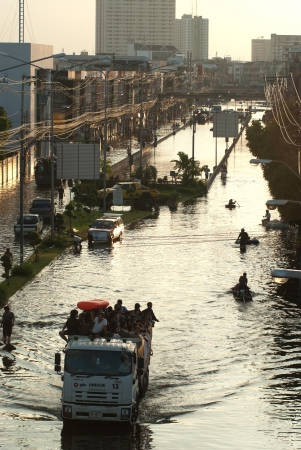 BANGKOK, THAILAND-OCTOBER 30  Transportation of people in the streets flooded after the heaviest monsoon rain in 50 years in the capital on October 30, 2011 Phahon Yothin Road, bangkok, Thailand   Stock Photo - 16680369