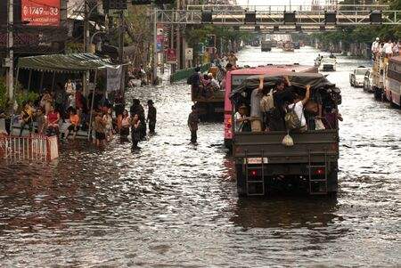 BANGKOK, THAILAND-NOVEMBER 11  Transportation of people in the streets flooded after the heaviest monsoon rain in 50 years in the capital on November 11, 2011 Phahon Yothin Road, bangkok, Thailand   Stock Photo - 16680360