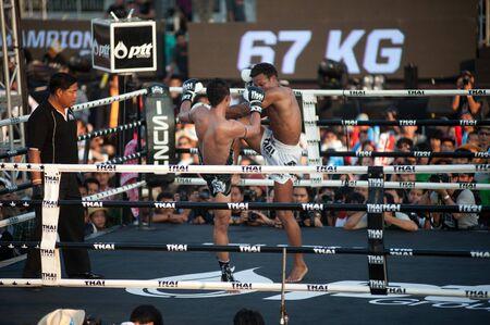 unrivaled: BANGKOK, THAILAND-NOV 27  Unidentified fighters fight Muaythai at Thai Fight Muay Thai    The World s Unrivaled Fight at Imperial Departmaent Store stadium on November 27, 2011 in Bangkok,Thailand