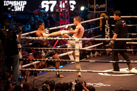 BANGKOK, THAILAND-NOV 27  Unidentified fighters fight Muaythai at Thai Fight Muay Thai    The World s Unrivaled Fight at Imperial Departmaent Store stadium on November 27, 2011 in Bangkok,Thailand