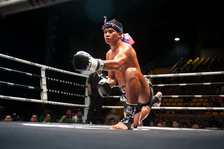 BANGKOK, THAILAND-SEPT 25  Unidentified fighters fight Muaythai at Thai Fight Muay Thai    The World s Unrivaled Fight at Thammasat University stadium on September 25, 2011 in Bangkok,Thailand