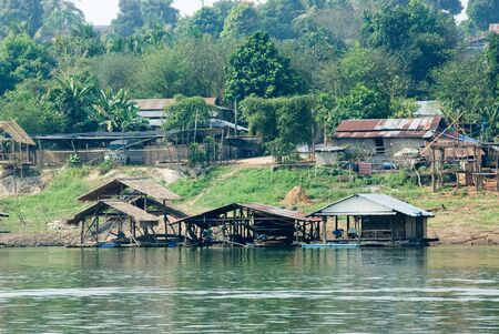 Floating house and long wood bridge in Middle of Thailand
