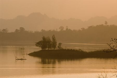Sunset at big lake in Kanchanaburi province, Thailand  photo
