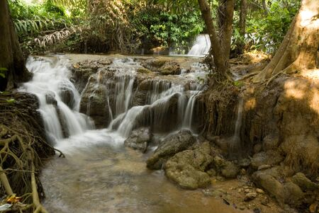 Waterfall in deep forest Stock Photo - 16799876