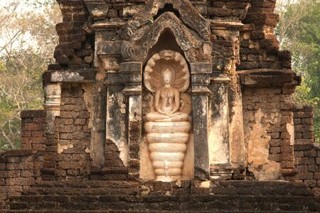 si: Ancient pagoda in Wat Jed Yod in Si Satchanalai historical park   Editorial