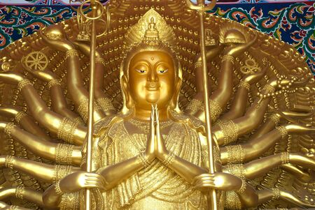 Thousand hands Kuan yin Buddha in Thai temple at Middle of Thailand   photo