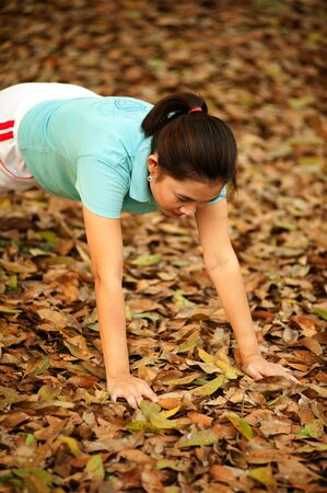 Thai woman exercise on ground in the park   photo