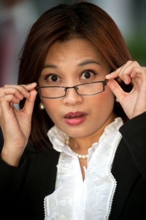 Beautiful Thai businesswoman wearing eyeglasses  photo