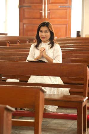 Pretty Thai woman is Praying in Retro styled   photo