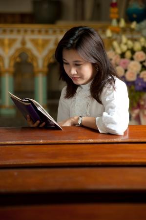 Pretty Thai woman stydy bible in Christian church   photo