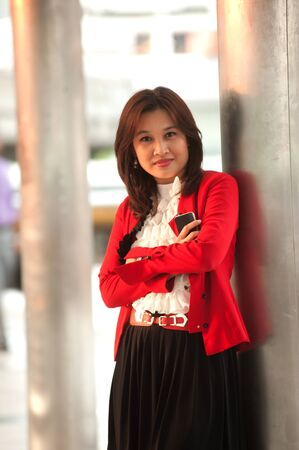 Smiling pretty Asian woman in red clothes  photo