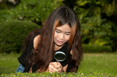 sagacious: Pretty Asian woman with magnifying glass   Stock Photo