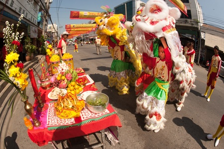 Lion give luck for peoples on parade show in Chinese New Year 2013 , Nakhonsawan Province,Middle of Thailand