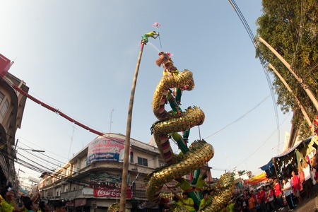 Golden Dragon playing show in parade on Chinese New Year 2013 in Nakhonsawan Province,Middle of Thailand