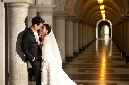 asian bride: A beautiful Asian bride and handsome groom at Christian church during wedding  Stock Photo