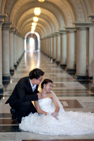 A beautiful Asian bride and handsome groom at Christian church during wedding  Stock Photo