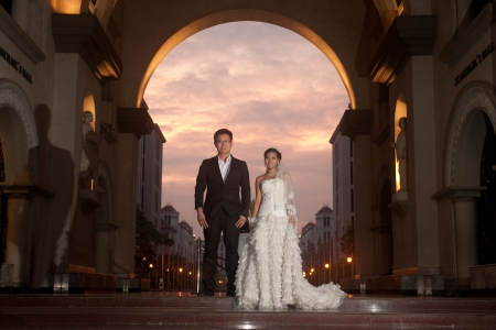 christian marriage: A beautiful Asian bride and handsome groom at Christian church during wedding  Stock Photo