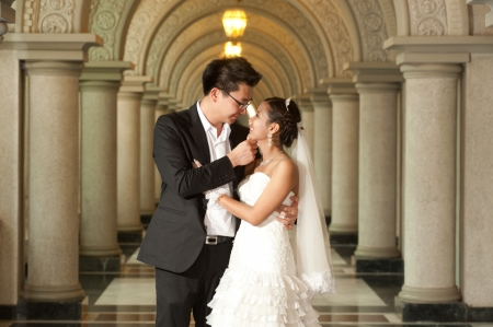 A beautiful Asian bride and handsome groom at Christian church during wedding  Standard-Bild