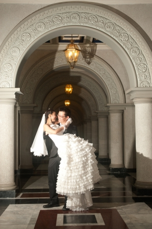 A beautiful Asian bride and handsome groom at Christian church during wedding  photo