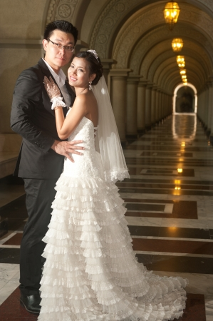 A beautiful Asian bride and handsome groom at Christian church during wedding  写真素材