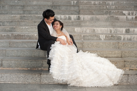 Happy Asian bride and groom on their wedding day   Stock Photo
