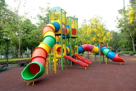 Colorful spiral tube slide at public playground  photo