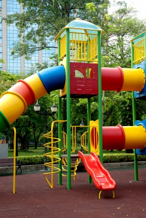 Colorful slide at public playground  Stock Photo