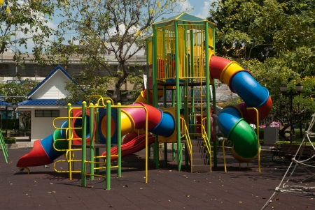 Colorful spiral tube slide at public playground