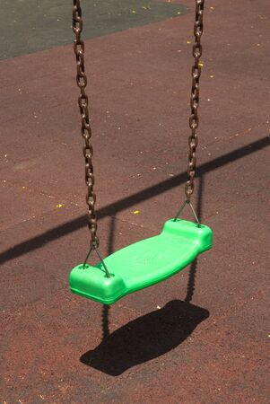 Colorful swing on the playground in the park   photo