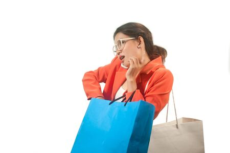 Busy young Asian business woman with shopping bags isolated on a white background   photo