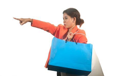 Young Asian business woman with shopping bags isolated on a white background   photo