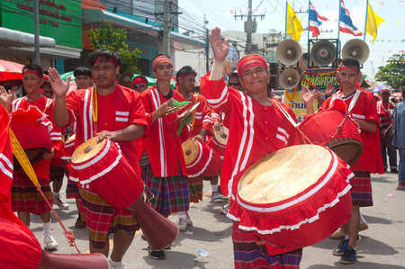 group of musicians with traditional long drum and gong on parades in Rocket Festival  Boon Bung Fai  in Northeast of Thailand