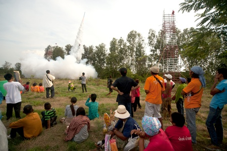 Rain fall hopes rocket up the sky in Boon Bung Fai Rocket Festival
