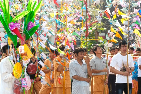 participants: Participants holding offering given as alms in Poy Sang Long Festival parades in Thailand