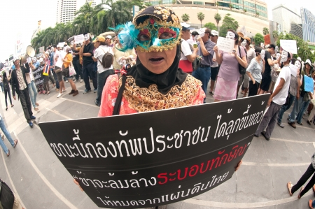 demonstrators: Bangkok,Thailand-June 2,2013   About 700 demonstrators from the anti-government V for Thailand group wear Guy Fawkes masks to protest against the government at the Central World shopping complex on June 2,2013 in Bangkok,Thailand